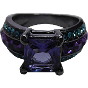 Lovely Costume Jewelry Ring Black Metallic Setting and Purple & Teal Crystals