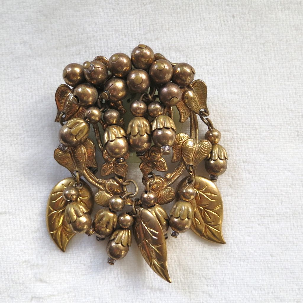 Early Miriam Haskell golden bead dangles dress clip