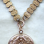 W&H Co. Art Nouveau gold tone locket and book chain necklace