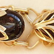 Black lucite cabochon link bracelet