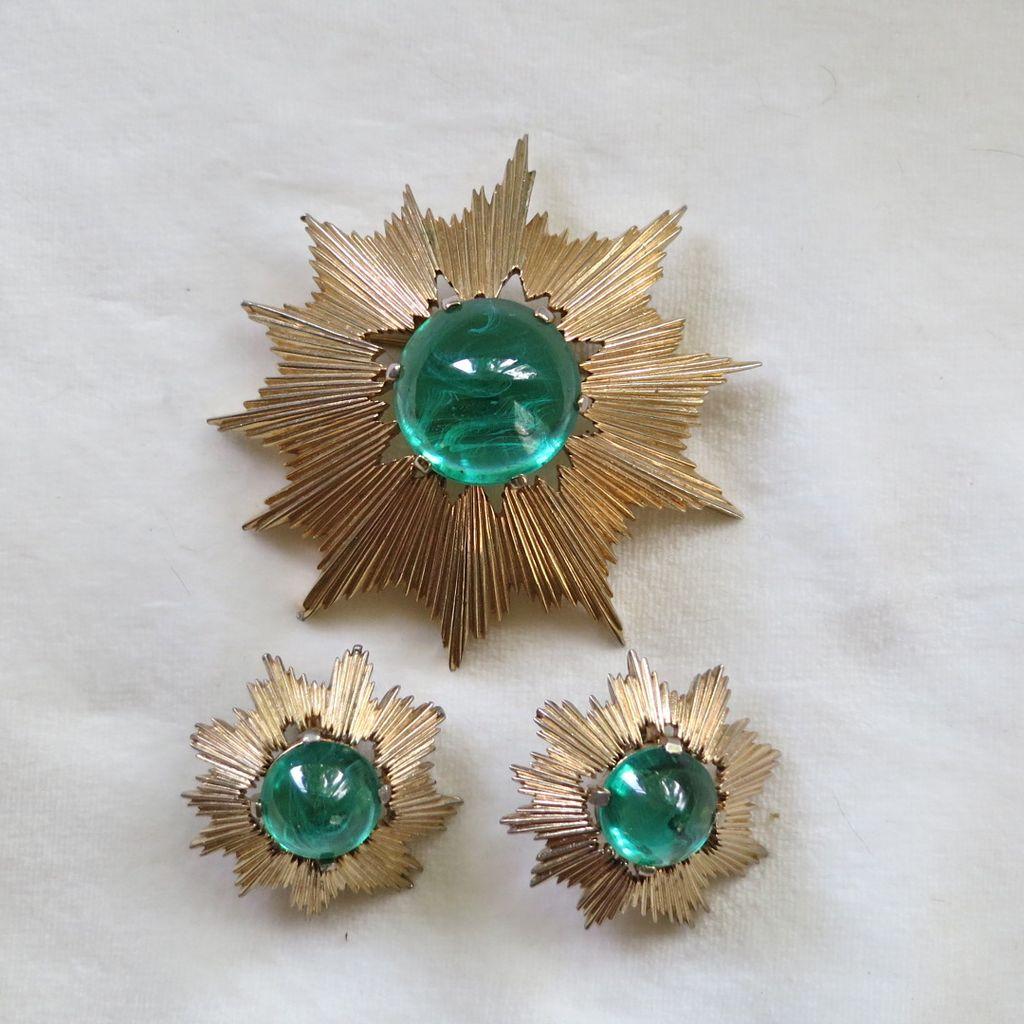 Trifari atomic sunburst and green flawed glass pin set