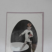 Early Postcard. Boy and his Golly, Golliwogg