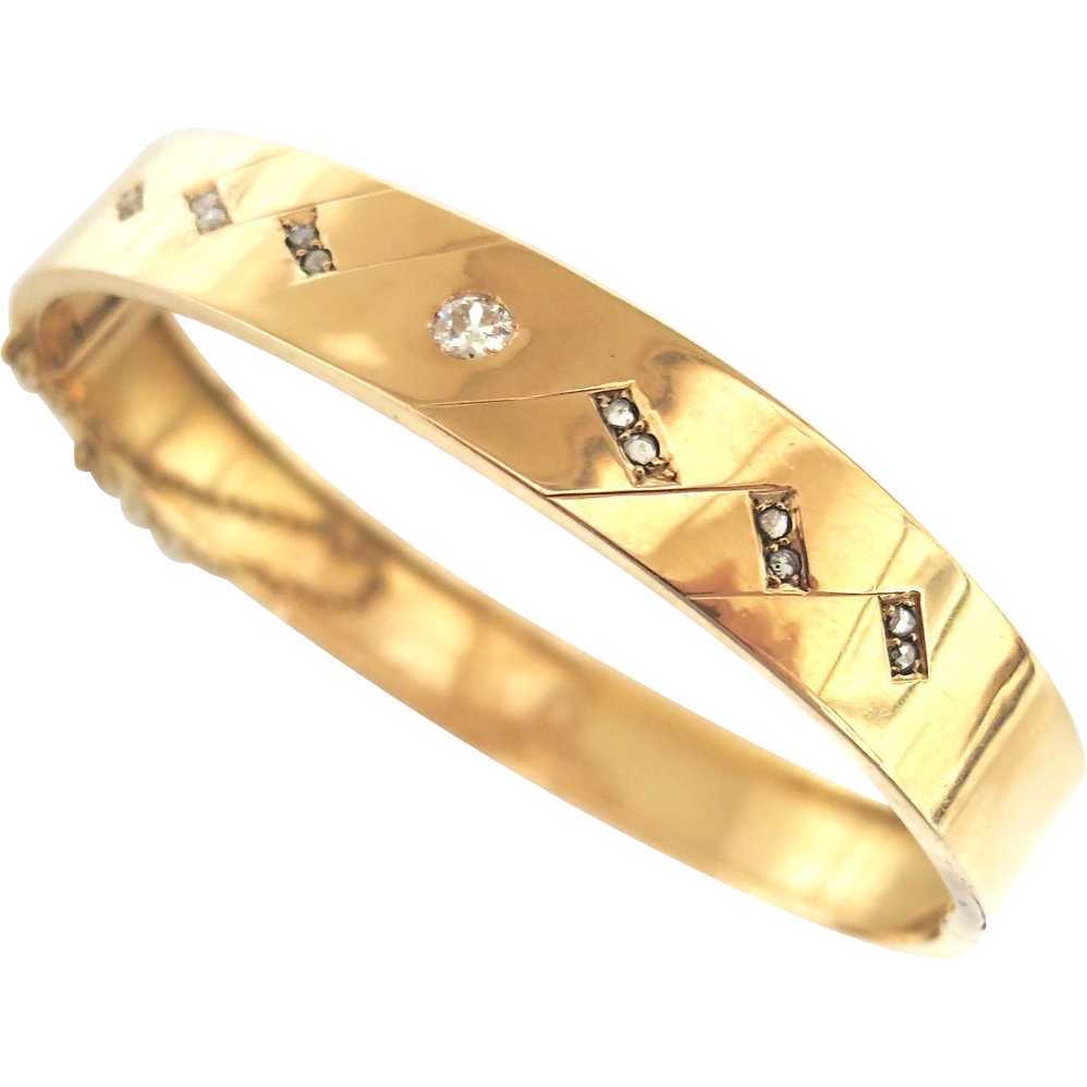 Handsome 14K Gold Bangle bracelet With Diamonds
