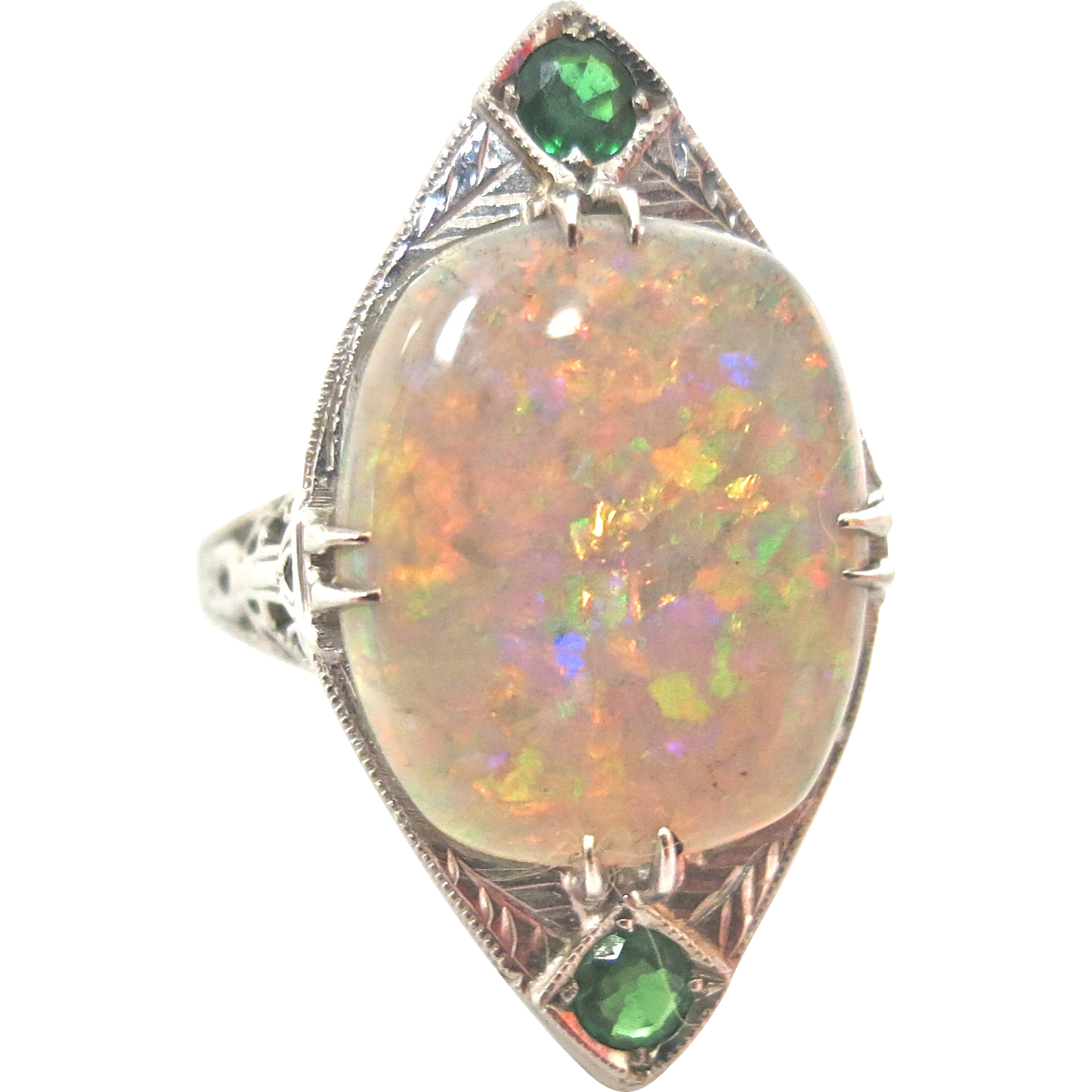 dramatic deco opal emerald ring from thepearl on ruby