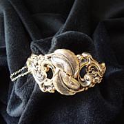 Glamorous Art Deco goldtone leaves and foliate scrolling openwork hinged bracelet