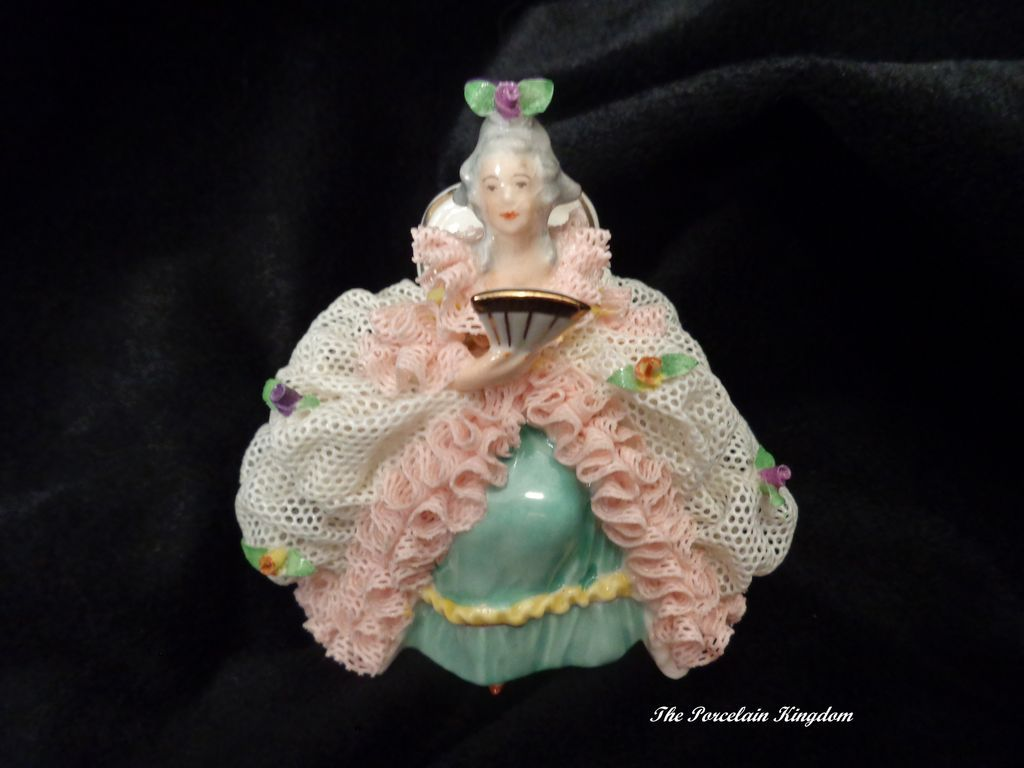 German porcelain lady with with fan in heavy lace costume