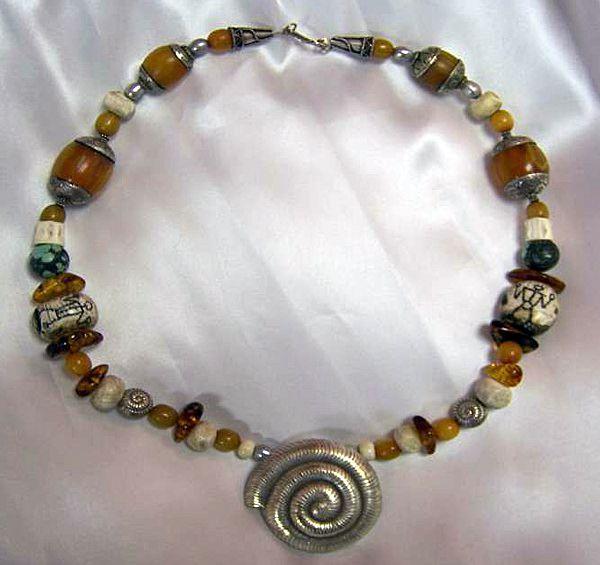 Tibetan Beeswax Amber beads, Conch beads : Naga Saga (Out of this World)