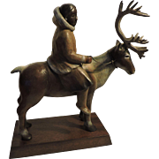LIZ WOLF bronze of Native American / Eskimo young woman riding a reindeer