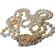 Angel skin enormous 226 gram double strand necklace with a fantastic coral clasp