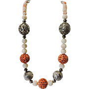 Salmon Coral Hollow Crouching Dragon Bead Necklace with Other Dragon Beads