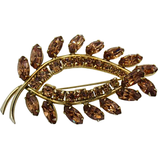 Sherman Amber Colored Rhinestone Brooch