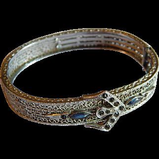 Flashy ART DECO Rhodium plated Filigree signed JMP sapphire blue rhinestone open work Ornate bangle bracelet