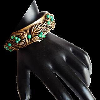 Ornate Green bead pine cone foliage Repousse Art Nouveau style brass hinged Bangle bracelet
