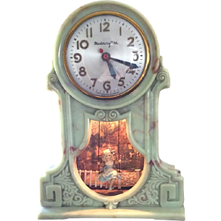Mastercrafters Swinging Girl Clock in Rare Green Swirl Color