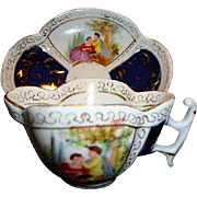 RARE German Porcelain Cup and Saucer ~ Hand Painted Quatrefoil Panels of Courting Scenes ~ Helena Wolfsohn 1800'S