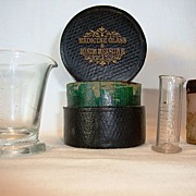 Medicine Glass and Minim Measuring Cups / Beakers in Leather made by Maw Son & Thompson, c. 1890.