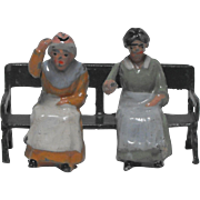 Britains Garden Seat or Bench with Seated Farmer's Daughter 561 and Seated Aged Villager Woman 556 with Movable Arms