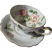 Porcelain Tea Cup Saucer with Roses on Three Feet