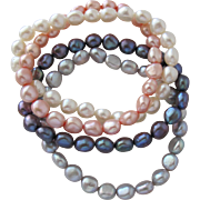 Four Pearl Bracelets of Cultured Freshwater Pearls Stretch Bracelet