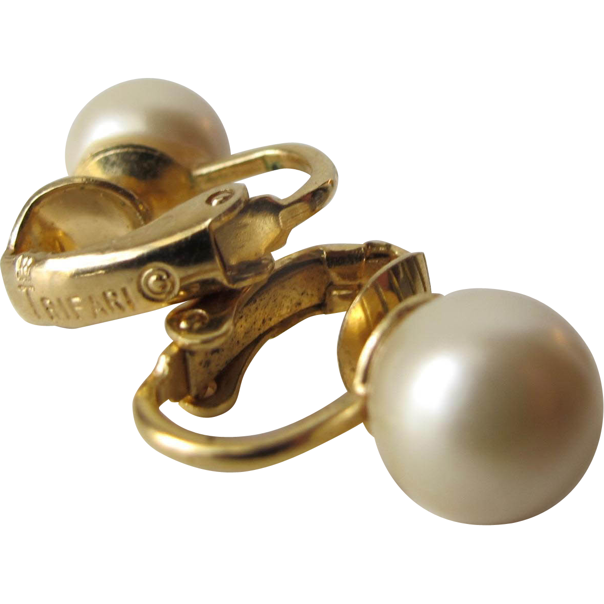 Earrings by Trifari Gold Tone Faux Pearl Clip on Earrings
