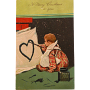 Christmas Postcard wth Baby Drawing Heart with Ink Well 1907