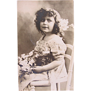 Post Card Black and White of Beautiful Girl in Hat with Flowers