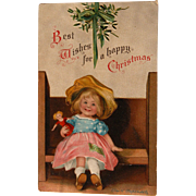 Artist Signed Christmas Postcard by Helen Clapsaddle Girl Doll and Mistletoe