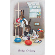 Easter Postcard with Dressed Rabbits Painting Easter Eggs