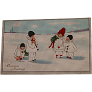 Christmas Postcard of Pierrots in the Snow 1910