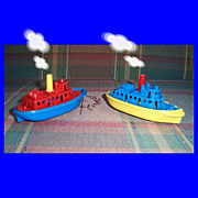 Two Colorful Renwal Plastic Tugboats