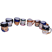 "Eight Occupied Japan Character Toby Mugs and Toby Creamers, 2 1/2"" to 2 5/8"" tall"