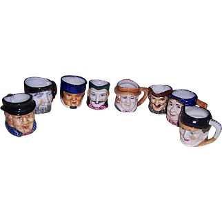 """Eight Occupied Japan Character Toby Mugs and Toby Creamers, 2 1/2"""" to 2 5/8"""" tall"""