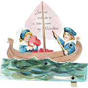 Vintage 1923 Motion Valentine Girl and Boy Paddling Canoe Die Cut