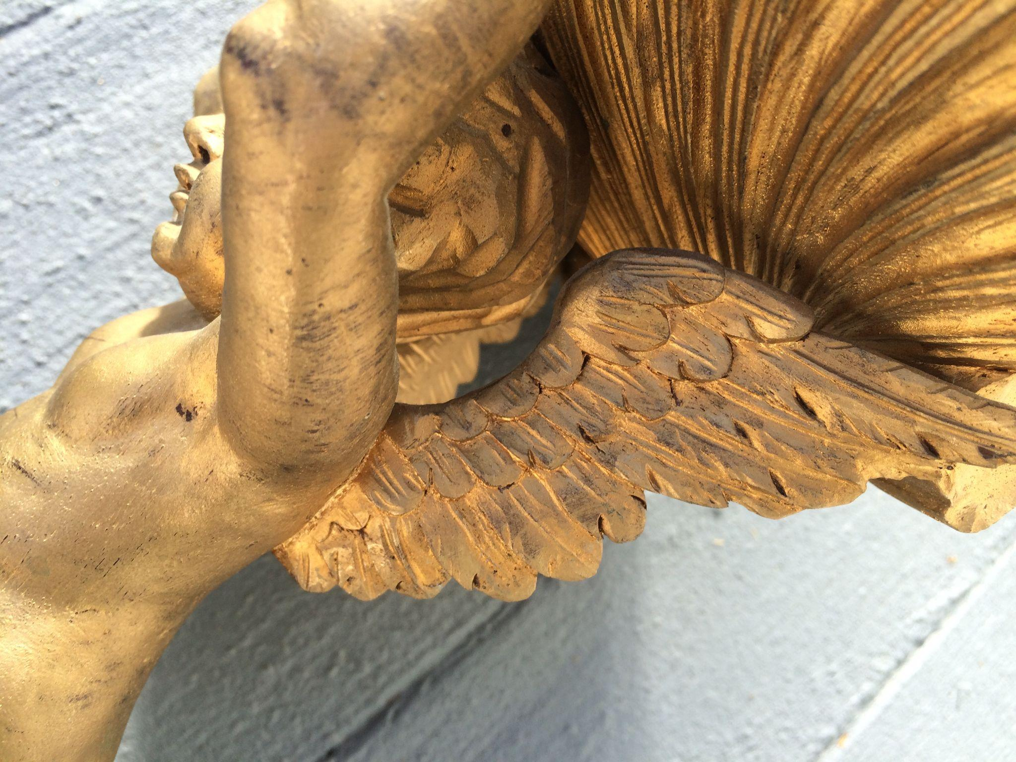 Gilded hand carved cherub shell sconce from tiques n