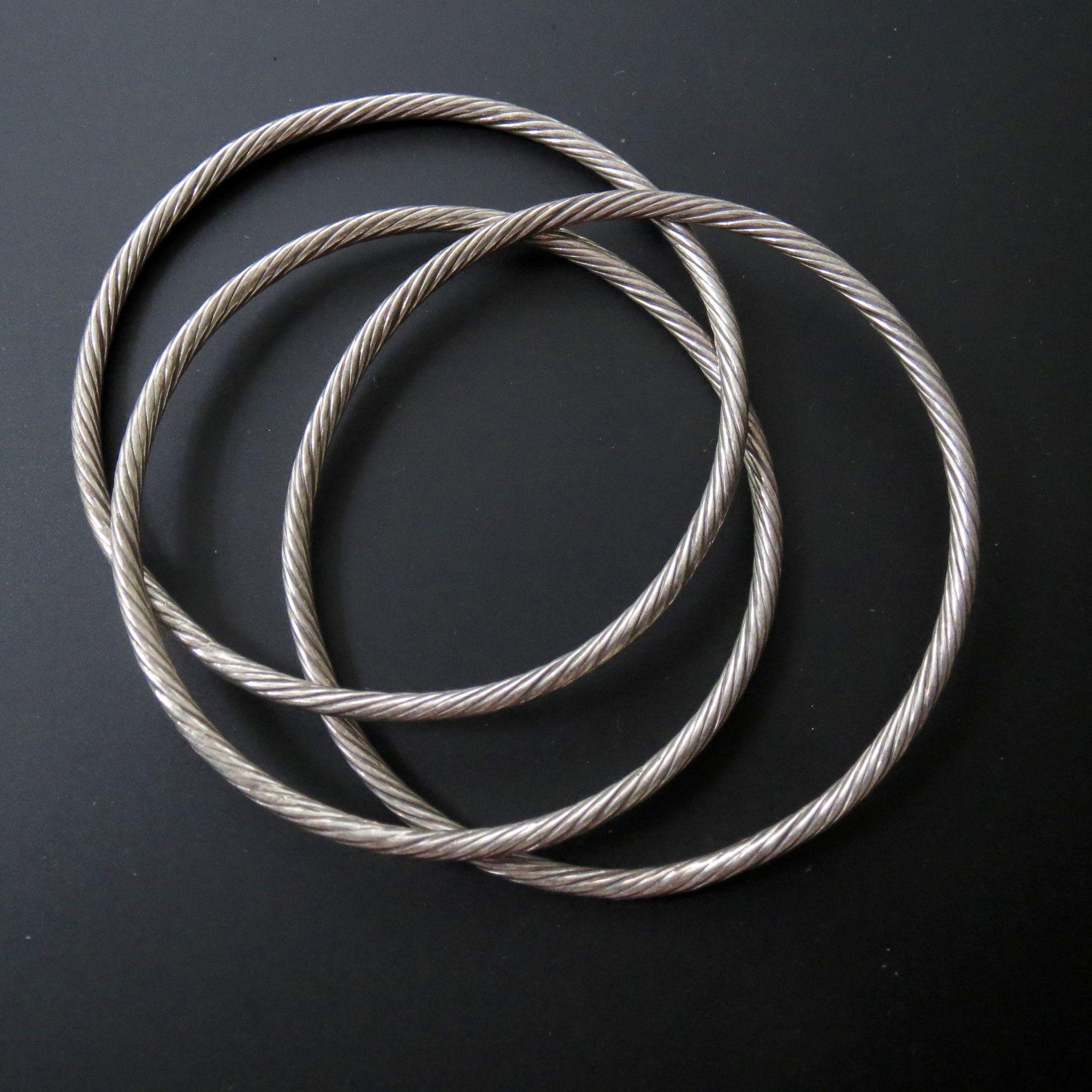 Mid-Century Silver Aluminum Entwined Bangle Trio