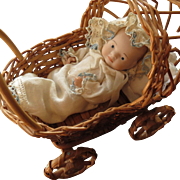 Vintage Porcelain Baby Doll in Wicker Carriage