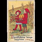1919 Thanksgiving Postcard Sweet Children Carry Pumpkin & Leaves