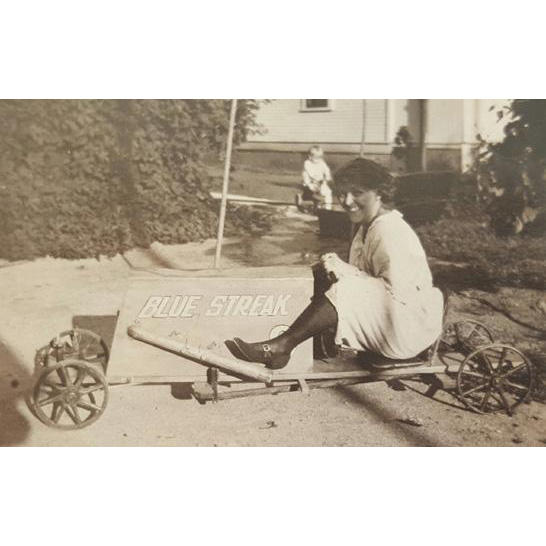 Black and White Photograph 1910 Woman on Blue Streak Coaster Toy Car