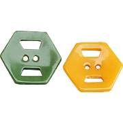 Two Bakelite Buttons Crazy Faces in Gold and Green