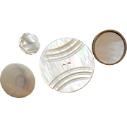 Four Vintage Mother of Pearl Buttons