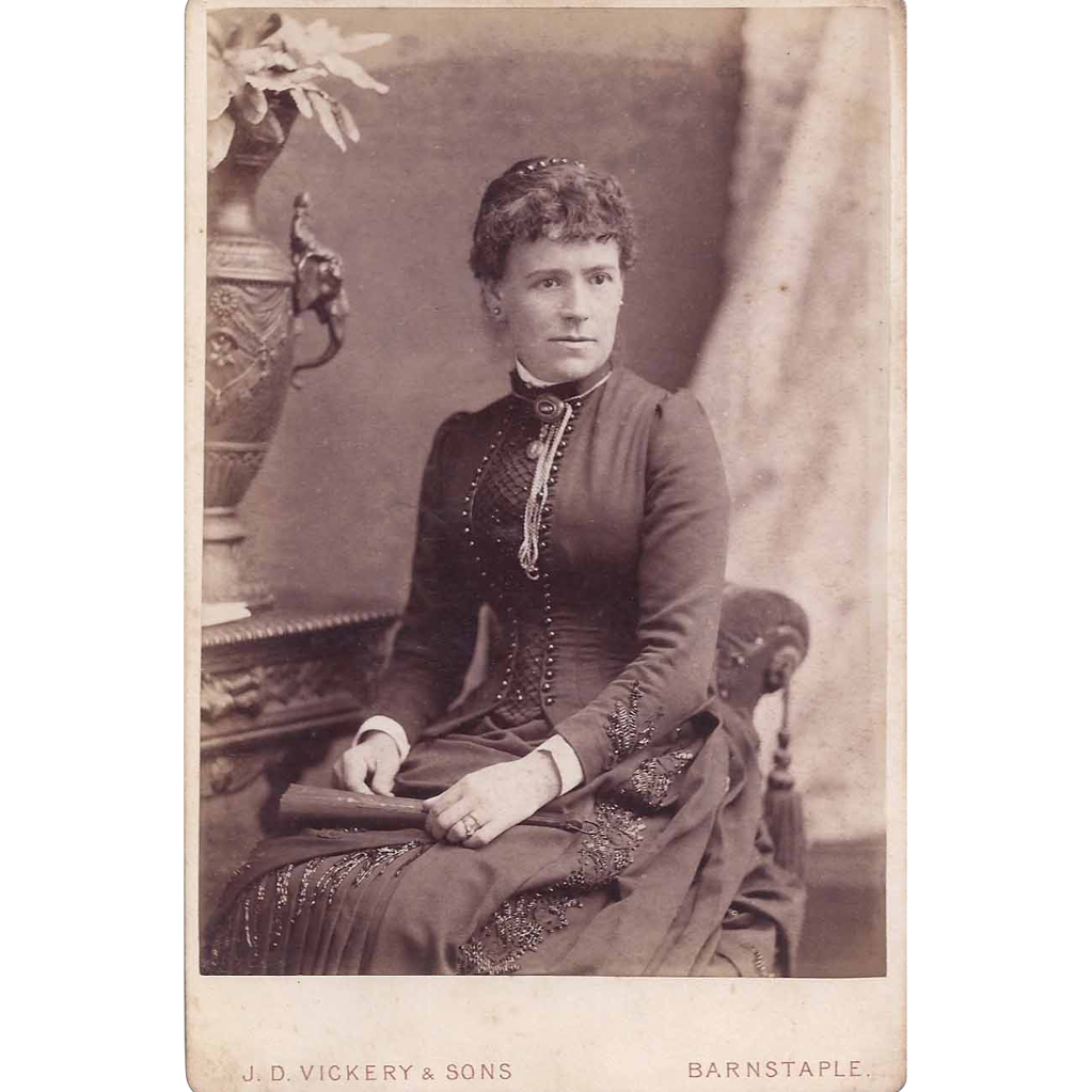 Cabinet Photograph of a Young Woman in Victorian Dress