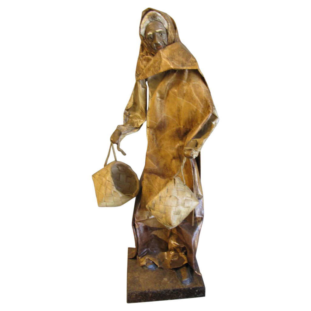 vintage paper mache figure woman carrying baskets from
