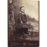 Cabinet Photograph of Young Boy with a Large Hoop, Victorian Dress