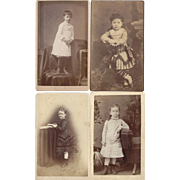 Group of Four Photographs of Young Children in the Victorian Era