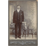 Full Length Photograph of Young Man in Victorian Setting