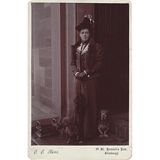 Cabinet Photograph Card of Woman Standing Outside Door with Two Dogs