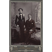Cabinet Photograph Card, Man & Woman in period dress with Victorian backdrop