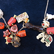 Art Deco Sterling Silver Necklace with 15 Celluloid Cracker Jack Japanese Kobe Charms