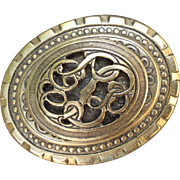 Victorian Revival Oval Pin with Pierced work Filigree made by Freirich, French Designer Costume Jewelry