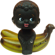 Black Girl on Banana Coin Bank ~ Florida Souvenir ~ Bobblehead